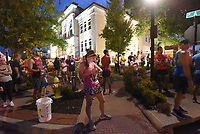 HALF MARATHON EARLY START<br />Runners wait at dawn on Saturday Oct. 9 2021 in front of the Benton County Courthouse for the 7 a.m. start of the 11th annual Run Bentonville Half Marathon. Some 2,100 runners registered for the half-marathon and 5-kilometer runs, said David Wright, Bentonville parks and recreation director. The event was held on trails and streets in the city. The 2020 run was virtual. This year's half-marathon was originally set for last spring, but was postponed until Saturday. The 2022 event is scheduled for spring 2022, Wright said. Go to nwaonline.com/211010Daily/ to see more photos.<br />(NWA Democrat-Gazette/Flip Putthoff)<br />(NWA Democrat-Gazette/Flip Putthoff)