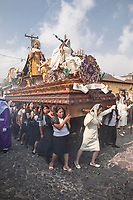 Antigua, Guatemala.  Semana Santa (Holy Week).  Women Carrying an Anda (Float) with the Virgin Mary in a Religious Procession.