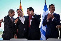 Pictured: Zoran Zaevat, Prime Minister for FYROM (2nd L) jokes with Greek Prime Minister Alexis Tsipras holds up his red tie at Prespa Lake in northern Greece. Sunday 17 June 2018<br /> Re: Greece and the Former Yugoslav Republic Of Macedonia (FYROM) have signed a deal that aims to settle a decades-long dispute over the country's name.<br /> Under the agreement, Greece's neighbour will be known as North Macedonia.<br /> Heated rows over Macedonia's name have been going on since the break-up of the former Yugoslavia, of which it was a part, and have held up Macedonia's entry to Nato and the EU.<br /> Greece has long argued that by using the name Macedonia, its neighbour was implying it had a claim on the northern Greek province also called Macedonia.<br /> The two countries' leaders, Mr Tsipras and his Macedonian counterpart Zoran Zaev announced the deal on Tuesday and have pressed ahead despite protests.<br /> The two countries' foreign ministers signed the deal on Lake Prespa on Greece's northern border on Sunday.<br /> The agreement still needs to be approved by both parliaments and by a referendum in Macedonia.