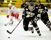 2 January 2011: Army Black Knight forward Bryant Skarda, a Junior from Lake Elmo, MN, in action against the Ohio State University Buckeyes at Gutterson Fieldhouse in Burlington, Vermont. The Buckeyes defeated the Black Knights 5-3 to win the 2010-2011 Catamount Cup. Mandatory Credit: Ed Wolfstein Photo