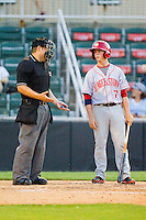 Tony Renda (7) of the Hagerstown Suns chats with home plate umpire Jorge Teran during the South Atlantic League game against the Kannapolis Intimidators at CMC-Northeast Stadium on May 17, 2013 in Kannapolis, North Carolina.  The Suns defeated the Intimidators 9-7.   (Brian Westerholt/Four Seam Images)