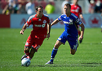 05 June 2010: Kansas City Wizards midfielder Jack Jewsbury #14 and Toronto FC midfielder Nick LaBrocca #21in action during a game between the Kansas City Wizards and Toronto FC at BMO Field in Toronto..The game ended in a 0-0 draw.05 June 2010: Toronto FC defender Nick Garcia #4 collides with Kansas City Wizards forward Kei Kamara #23 during a game between the Kansas City Wizards and Toronto FC at BMO Field in Toronto..The game ended in a 0-0 draw.