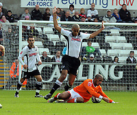 ATTENTION SPORTS PICTURE DESK<br /> Pictured: Darren Pratley of Swansea (L) tackled by Hameur Bouazza of Blackpool (R)<br /> Re: Coca Cola Championship, Swansea City Football Club v Blackpool at the Liberty Stadium, Swansea, south Wales. Saturday 24 October 2009