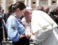 Papa Francesco bacia un bambino al termine dell'incontro con gli scout dell'Agesci in Piazza San Pietro, Citta' del Vaticano, 13 giugno 2015.<br /> Pope Francis kisses a baby at the end of a meeting with Italian AGESCI boy scout association's members in St. Peter's Square at the Vatican, 13 June 2015.<br /> UPDATE IMAGES PRESS/Isabella Bonotto<br /> <br /> STRICTLY ONLY FOR EDITORIAL USE