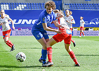 forward Lotte Van Den Steen (15) of KRC Genk battles for the ball with Ella Vierendeels (4) of Zulte-Waregem during a female soccer game between  Racing Genk Ladies and SV Zulte-Waregem on the 18 th and last matchday before the play offs of the 2020 - 2021 season of Belgian Scooore Womens Super League , saturday 27 th of March 2021  in Genk , Belgium . PHOTO SPORTPIX.BE | SPP | JILL DELSAUX