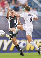 Shannon Boxx of the Power and Kylie Bivens of the Beat both go for the ball. The Atlanta Beat and the NY Power played to a 1-1 tie on 7/26/03 at Mitchel Athletic Complex, Uniondale, NY.