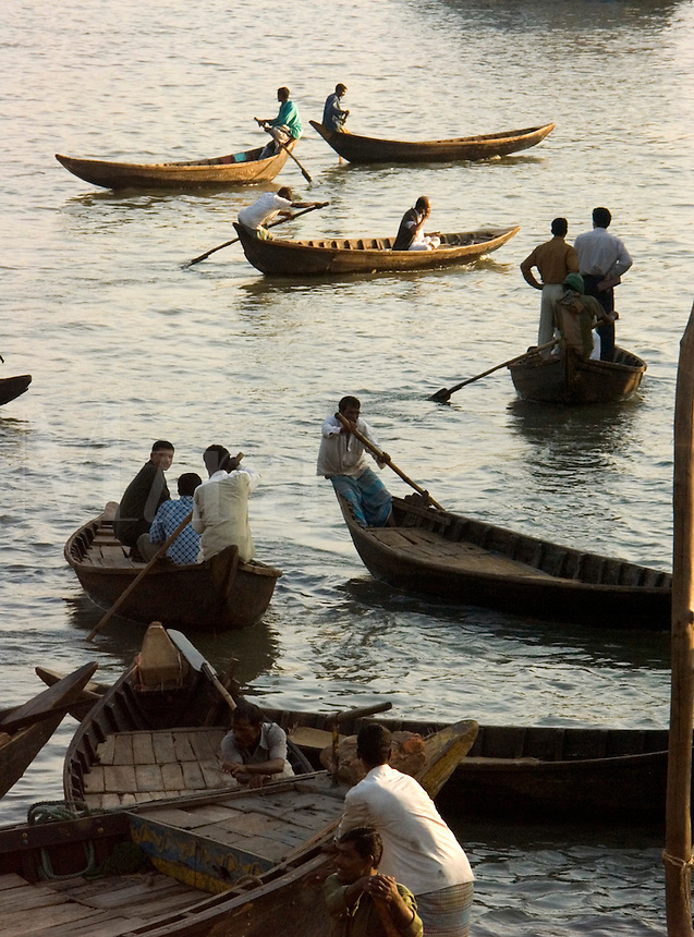 December, 2003 Boats in the harbor of the Buriganaga river carry passengers and freight in Dacca, Bangladesh