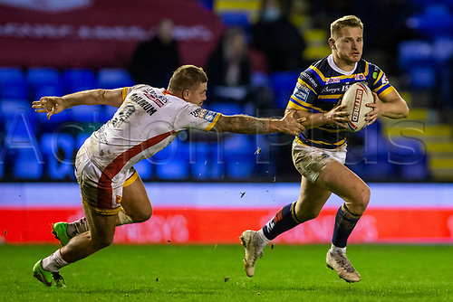 13th November 2020; The Halliwell Jones Stadium, Warrington, Cheshire, England; Betfred Rugby League Playoffs, Catalan Dragons versus Leeds Rhinos; Brad Dwyer of Leeds Rhinos outruns the tackle from Michael Mcllorum of Catalans Dragons