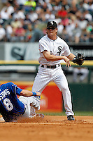 Chicago White Sox Gordon Beckham #15 turns a double play as Mike Moustakas #8 slides in during a game against the Kansas City Royals at U.S. Cellular Field on August 14, 2011 in Chicago, Illinois.  Chicago defeated Kansas City 6-2.  (Mike Janes/Four Seam Images)