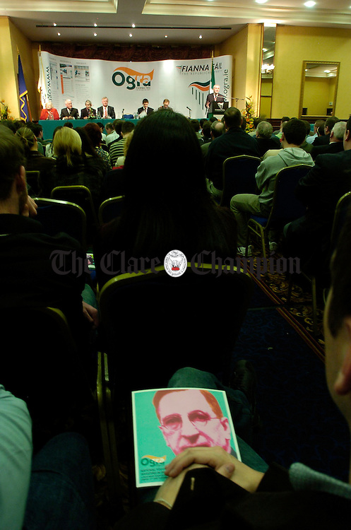 Founding Father of Fianna Fail, Eamon de Valera on the front cover of some literature as the Taoiseach,  Bertie Aherne  adresses delegates at the Ogra Fianna Fail conferennce in Ennis. Photograph by John Kelly.