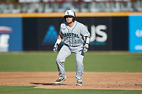 Hunter Ashburn (47) of the Coastal Carolina Chanticleers takes his lead off of first base against the Duke Blue Devils at Segra Stadium on November 2, 2019 in Fayetteville, North Carolina. (Brian Westerholt/Four Seam Images)