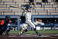 Michigan Wolverines shortstop Benjamin Sems (2) follows through on his swing during the NCAA baseball game against the Illinois Fighting Illini at Fisher Stadium on March 19, 2021 in Ann Arbor, Michigan. Illinois won the game 7-4. (Andrew Woolley/Four Seam Images)