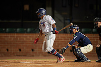 Jacksonville Jumbo Shrimp Stone Garrett (31) hits a single in front of catcher Jack Kruger (10) during a Southern League game against the Mobile BayBears on May 7, 2019 at Hank Aaron Stadium in Mobile, Alabama.  Mobile defeated Jacksonville 2-0.  (Mike Janes/Four Seam Images)