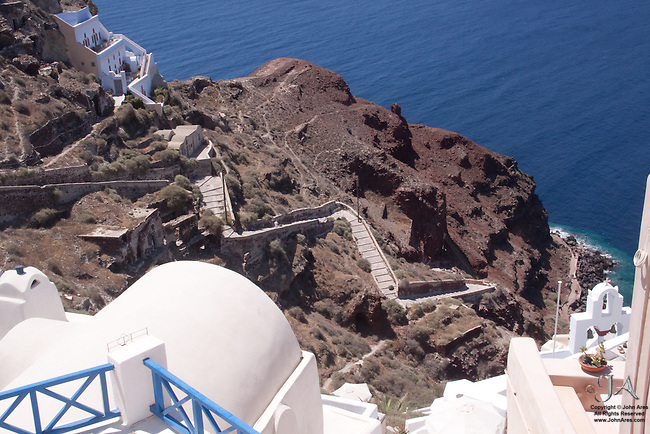 Staircase descending to Ammoudi Harbor