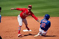 St. Louis Cardinals shortstop Edmundo Sosa (63) tags Francisco Lindor (12) while sliding into second base out during a Major League Spring Training game against the New York Mets on March 19, 2021 at Clover Park in St. Lucie, Florida.  (Mike Janes/Four Seam Images)