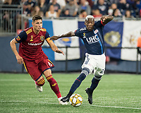 FOXBOROUGH, MA - SEPTEMBER 21: Damir Kreilach #8 of Real Salt Lake comes in to tackle Luis Caicedo #27 of New England Revolution during a game between Real Salt Lake and New England Revolution at Gillette Stadium on September 21, 2019 in Foxborough, Massachusetts.