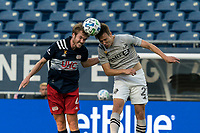 FOXBOROUGH, MA - SEPTEMBER 23: Henry Kessler #4 of New England Revolution and Lassi Lappalainen #21 of Montreal Impact battle for head ball during a game between Montreal Impact and New England Revolution at Gillette Stadium on September 23, 2020 in Foxborough, Massachusetts.