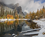 Yosemite National Park, CA: Clearing snowstorm reveals the Three Brothers reflected in the Merced River in late fall