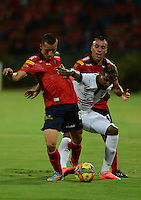MEDELLÍN -COLOMBIA-03-08-2014. John Hernandez (Izq) y Vladimir Marin (Der) jugadores de Independiente Medellín disputan el balón con Johan Angulo Ambuila (C)  jugador del Once Caldas de la fecha 3 de la Liga Postobón II 2014 realizado en el estadio Atanasio Girardot de la ciudad de Medellín./ Daniel Hernandez (L) and Vladimir Marin (R) players of Independiente Medellin fight the ball with Johan Angulo Ambuila(C) player of Once Caldas during 3th date of Postobon  League II 2014 at Atanasio Girardot stadium in Medellin city. Photo: VizzorImage/Luis Ríos/STR
