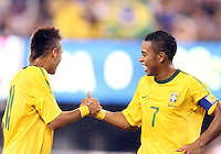 Robinho #7 of Brazil congratulates Neymar #11 after he had scored during an international friendly match against the USA in Giants Stadium, on August 10 2010, in East Rutherford, New Jersey. Brazil won 2-0.