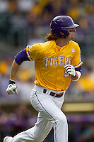 LSU Tigers outfielder Mark Laird (9) runs to first base during the Southeastern Conference baseball game against the Texas A&M Aggies on April 25, 2015 at Alex Box Stadium in Baton Rouge, Louisiana. Texas A&M defeated LSU 6-2. (Andrew Woolley/Four Seam Images)