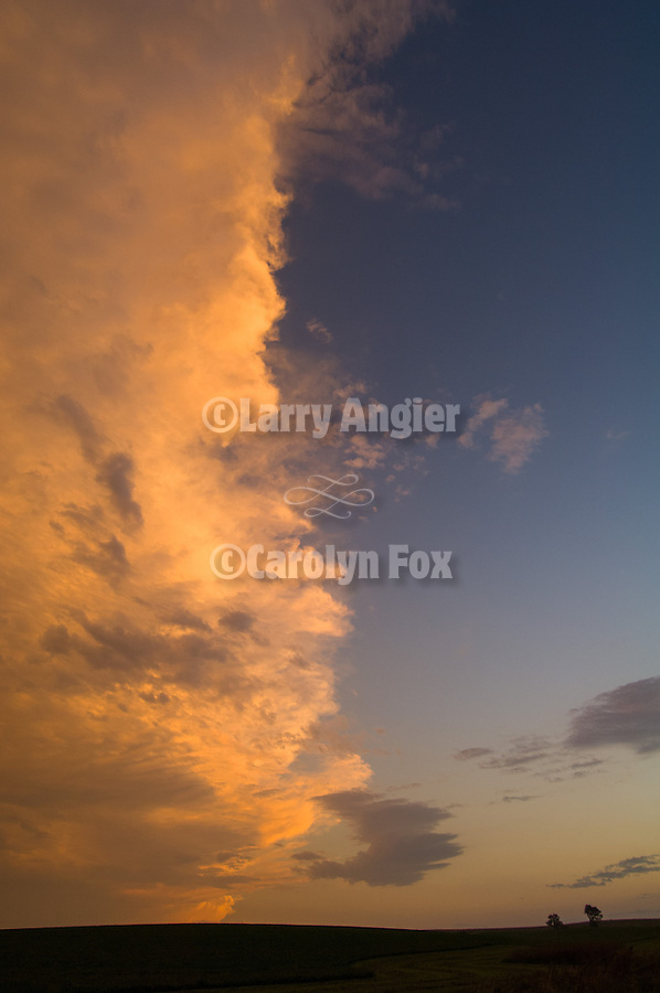 Trailing edge of an evening thunderstorm in the eastern Sand Hills of Nebrask, clouds at sun down