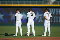 (L-R) Charlotte Knights outfielders Charlie Tilson (1), Luis Robert (9), and Daniel Palka (7) stand for the National Anthem prior to the game against the Buffalo Bisons at BB&T BallPark on July 24, 2019 in Charlotte, North Carolina. The Bisons defeated the Knights 8-4. (Brian Westerholt/Four Seam Images)
