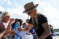 Orlando, Florida - Thursday, June 23, 2016: Orlando Pride goalkeeper Ashlyn Harris (1) takes time to sign an autograph upon entering the stadium prior to a National Women's Soccer League match between Orlando Pride and Houston Dash at Camping World Stadium.