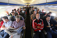 Wednesday 07 August 2013<br /> Pictured: Club Chirman Huw Jenkins (L), assistant coach Morten Wieghorst (4th L) and manager Michael Laudrup on the aeroplane en route to Malmo.<br /> Re: Swansea City FC travelling to Sweden for their Europa League 3rd Qualifying Round, Second Leg game against Malmo.