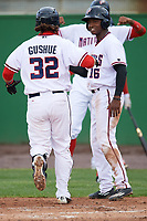 Potomac Nationals Victor Robles (16) congratulates Taylor Gushue (32) after hitting a home run during the first game of a doubleheader against the Salem Red Sox on May 13, 2017 at G. Richard Pfitzner Stadium in Woodbridge, Virginia.  Potomac defeated Salem 6-0.  (Mike Janes/Four Seam Images)