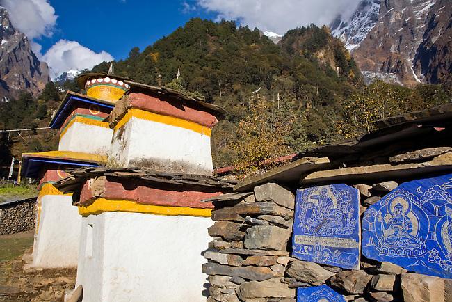 MANI WALL and CHORTENS at a A TIBETAN BUDDHIST MONASTERY -  NEPAL HIMALAYA