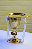 Wine chalice on the altar in the school Chapel.  Roman Catholic State secondary school.