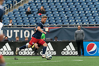 FOXBOROUGH, UNITED STATES - MAY 28: Pierre Cayet #44 of New England Revolution II brings the ball forward during a game between Fort Lauderdale CF and New England Revolution II at Gillette Stadium on May 28, 2021 in Foxborough, Massachusetts.