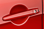 Closeup deatil of a red car door handle on a 2008 Mitsubishi Lancer Evolution