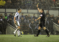 Pictured: Nicky Shorey of West Bromwich (L) sees a yellow card by match referee Jonathan Moss (R). Saturday, 04 February 2012<br /> Re: Premier League football, West Bromwich Albion v Swansea City FC v at the Hawthorns Stadium, Birmingham, West Midlands.