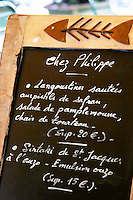Restaurant Chez Philippe. The menu on a chalk board. Marseillan. Languedoc. France. Europe.