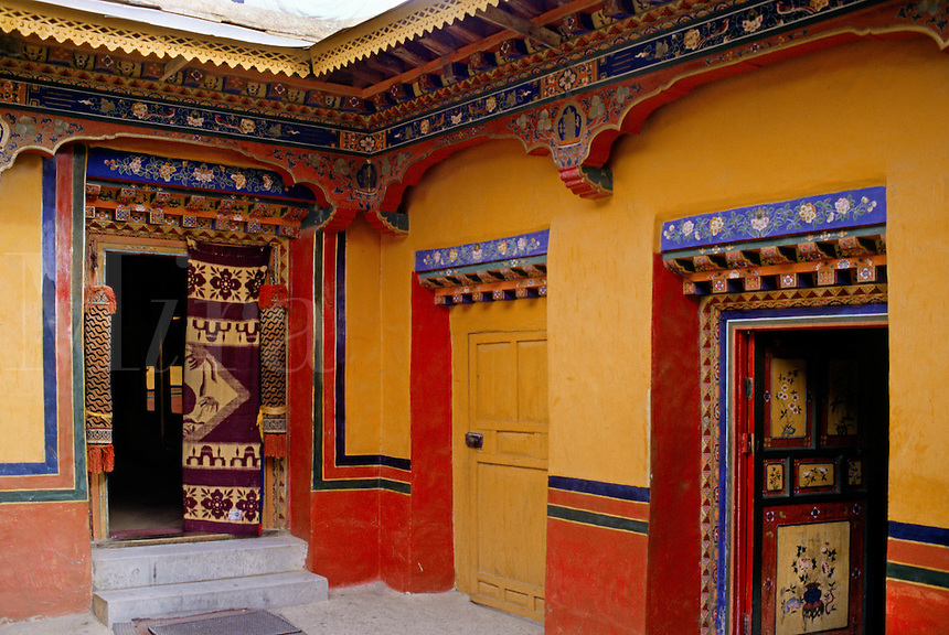 Courtyard doorways inside the NEW SUMMER PALACE completed in 1954 for the current DALAI LAMA - NORBULINGKA, LHASA, TIBET