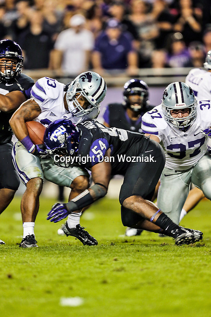 TCU Horned Frogs linebacker Marcus Mallet (54) tackles Kansas State Wildcats running back John Hubert (33) during the game between the Kansas State Wildcats and the TCU Horned Frogs at the Amon G. Carter Stadium in Fort Worth, Texas. Kansas State defeats TCU 23 to 10....