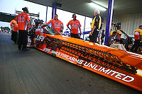 Apr 25, 2014; Baytown, TX, USA; Crew members for NHRA top fuel dragster driver J.R. Todd during qualifying for the Spring Nationals at Royal Purple Raceway. Mandatory Credit: Mark J. Rebilas-