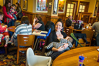 A mother breastfeeding her baby at the table in a pub restaurant.<br /> Lancashire, England, UK<br /> <br /> Date Taken:<br /> 07-01-2015<br /> <br /> © Paul Carter / wdiip.co.uk