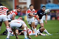 Fumiaki Tanaka of Japan passes the ball. Rugby World Cup Pool B match between Scotland and Japan on September 23, 2015 at Kingsholm Stadium in Gloucester, England. Photo by: Patrick Khachfe / Stewart Communications