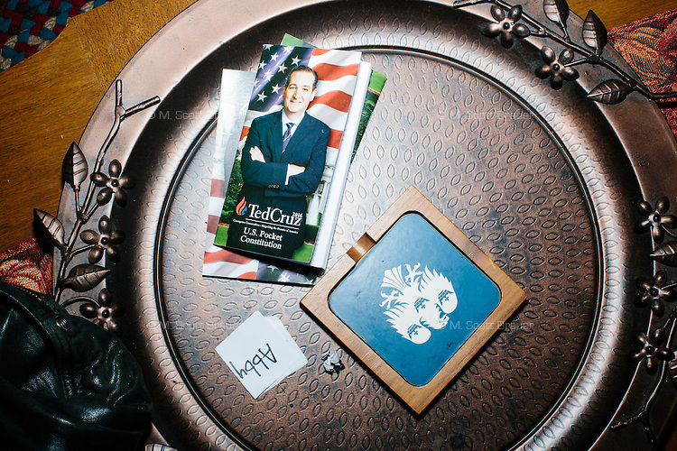 """Campaign materials lay on a coffee table while Texas senator and Republican presidential candidate Ted Cruz speaks at an event called """"Smoke a cigar with Ted Cruz"""" at a house party at the home of Linda & Steven Goddu Salem, New Hampshire. Cruz briefly smoked a cigar after speaking at the event."""
