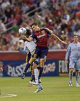Colorado Rapids midfielder Mehdi Ballouchy (8) and Real Salt Lake forward Fabian Espindola (16) battle for a head ball. Real Salt Lake tied the Colorado Rockies, 1-1, at Rio Tinto Stadium on June 6, 2009