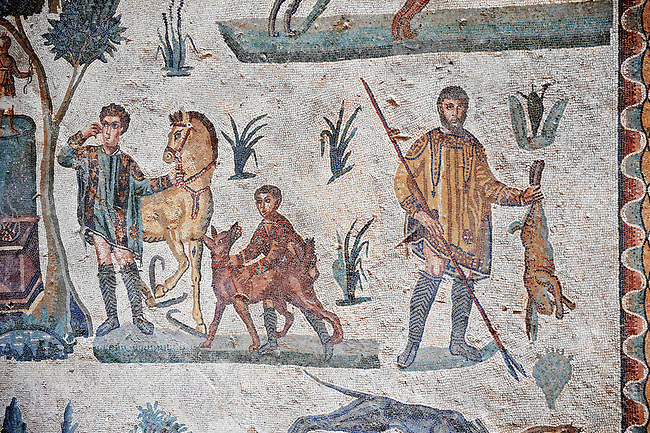 Hunter with a hare. Roman mosaic floor of the Room of The Small Hunt, no 25 - Roman mosaics at the Villa Romana del Casale ,  circa the first quarter of the 4th century AD. Sicily, Italy. A UNESCO World Heritage Site.