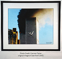 The image captured by Carmen Taylor of United Airlines Flight 175 just before crashing into the World Trade Center south tower on Sept. 11, 2001. Taylor was at the U.S. Marshals Museum were a 911 display of photographs of that day and the aftermath are set up in Fort Smith.  (Special to NWA Democrat Gazette/Brian Sanderford)