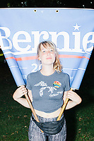 Deb Ennis, 26, of Michigan, shows how she carried a Bernie banner while rollerblading with protests outside of the secure area surrounding the Democratic National Convention at the Wells Fargo Center in Philadelphia, Pennsylvania, on Wed., July 27, 2016.  The two have been staying with a Trump supporter who opened his house to them through Craigslist after the pair couldn't find a camping spot for their time in Philadelphia.