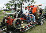 Goshen, CT-18 June 2011-061811JH02- From left to right, Eric Peterson, Eric Peterson, Addision Moon, aportrait of three generations of tractor pullers, during the Tri-State Tractor Pull at the Goshen Stampede Saturday afternoon in Goshen Fairground in Goshen.   Junfu Han Republican-American