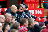 Luke Shaw of Manchester United sits on the substitutes bench during the Premier League match between Manchester United and Swansea City at the Old Trafford, Manchester, England, UK. Saturday 31 March 2018