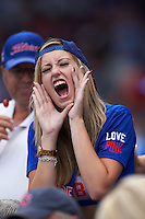 Chicago Cubs fan cheers during a game against the Milwaukee Brewers on August 13, 2015 at Wrigley Field in Chicago, Illinois.  Chicago defeated Milwaukee 9-2.  (Mike Janes/Four Seam Images)