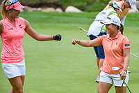 16th July 2021, Midland, MI, USA;  Lexi Thompson (USA) congratulates her teammate Nasa Hataoka (JPN) after she sank their birdie putt on 14 during the Dow Great Lakes Bay Invitational Rd3 at Midland Country Club on July 16, 2021 in Midland, Michigan.